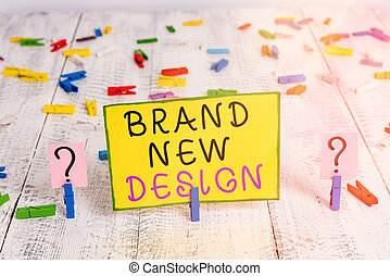 Text sign showing Brand New Design. Conceptual photo Brainstorming About Branding Strategy and Product Identity Scribbled and crumbling sheet with paper clips placed on the wooden table.
