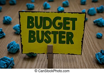Text sign showing Budget Buster. Conceptual photo Carefree Spending Bargains Unnecessary Purchases Overspending Clothespin holding yellow paper note crumpled papers several tries mistakes.