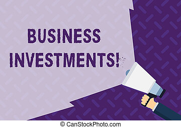 Text sign showing Business Investments. Conceptual photo act of committing money or capital to an endeavor Hand Holding Megaphone with Blank Wide Beam for Extending the Volume Range.
