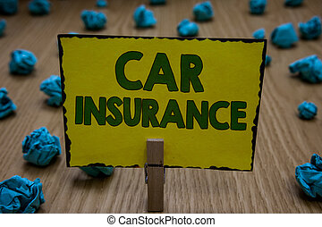 Text sign showing Car Insurance. Conceptual photo Accidents coverage Comprehensive Policy Motor Vehicle Guaranty Clothespin holding yellow paper note crumpled papers several tries mistakes.