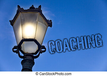 Text sign showing Coaching. Conceptual photo Prepare Enlightened Cultivate Sharpening Encourage Strenghten Light post blue sky enlighten ideas message old vintage antique Victorian.