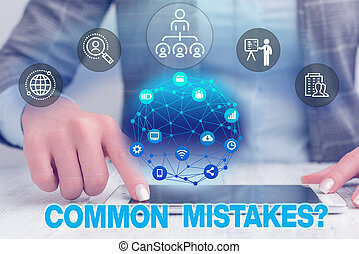 Text sign showing Common Mistakes question. Conceptual photo repeat act or judgement misguided or wrong Female human wear formal work suit presenting presentation use smart device.
