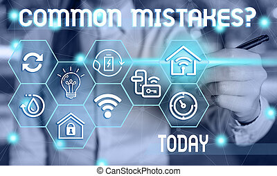 Text sign showing Common Mistakes Question. Conceptual photo repeat act or judgement misguided making something wrong Female human wear formal work suit presenting presentation use smart device.