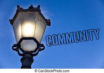 Text sign showing Community. Conceptual photo Neighborhood Association State Affiliation Alliance Unity Group Light post blue sky enlighten ideas message old vintage antique Victorian.