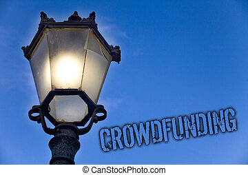 Text sign showing Crowdfunding. Conceptual photo Funding a project by raising money from large number of people Light post blue sky enlighten ideas message old vintage antique Victorian.