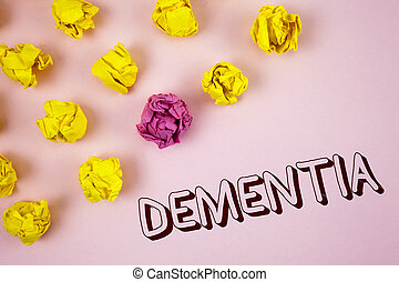 Text sign showing Dementia. Conceptual photo Long term memory loss sign and symptoms made me retire sooner written on plain Pink background Crumpled Paper Balls next to it.