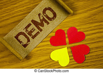 Text sign showing Demo. Conceptual photo Demonstration of products by software companies are displayed annually written on Folded Cardboard Paper piece on wooden background Paper Hearts next to it