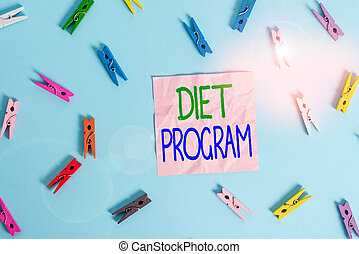 Text sign showing Diet Program. Conceptual photo practice of eating food in a regulated and supervised fashion Colored clothespin rectangle shaped reminder paper light blue background.