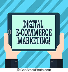 Text sign showing Digital E Commerce Marketing. Conceptual photo buying and selling of goods and services online Hu analysis Hand Holding Blank Screen Tablet Smartphone Display Unit photo.