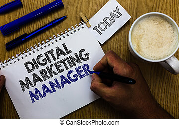 Text sign showing Digital Marketing Manager. Conceptual photo optimized for posting in online boards or careers Man holding marker notebook clothespin reminder wooden table cup coffee.