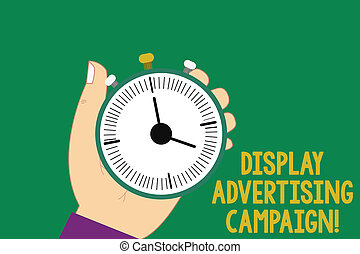 Text sign showing Display Advertising Campaign. Conceptual photo conveys a commercial message using graphics Hu analysis Hand Holding Mechanical Stop Watch Timer with Start Stop Button.