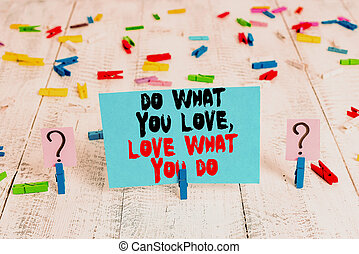 Text sign showing Do What You Love Love What You Do. Conceptual photo you able doing stuff you enjoy it to work in better places then Scribbled and crumbling sheet with paper clips placed on the wooden table.