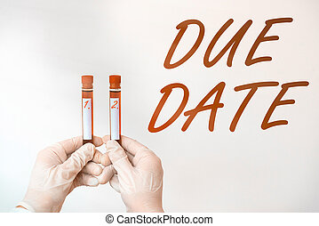 Text sign showing Due Date. Conceptual photo the day or date by which something is supposed to be done or paid Extracted blood sample vial ready for medical diagnostic examination.