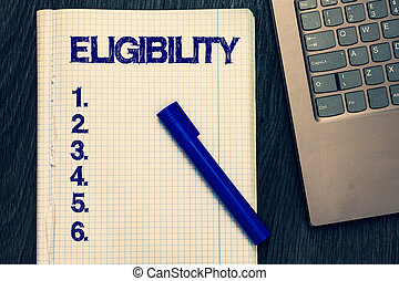 Text sign showing Eligibility. Conceptual photo State of having the right for doing or obtain something Proper Open notebook squared page black marker computer keyboard wooden background