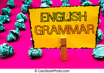 Text sign showing English Grammar. Conceptual photo Language Knowledge School Education Literature Reading Clothespin hold holding yellow paper black red letters crumpled papers idea.