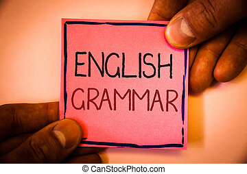 Text sign showing English Grammar. Conceptual photo Language Knowledge School Education Literature Reading Man hold holding pink paper ideas black red letters frame shadow on wall.