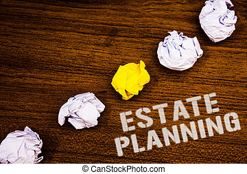 Text sign showing Estate Planning. Conceptual photo Insurance Investment Retirement Plan Mortgage Properties Ideas concepts words on wooden background crumpled papers several tries.