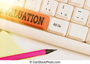Text sign showing Evaluation. Conceptual photo the making of judgment about the amount or value of something Different colored keyboard key with accessories arranged on empty copy space.
