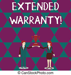 Text sign showing Extended Warranty. Conceptual photo contract which gives a prolonged warranty to consumers Man and Woman in Business Suit Holding Together the Championship Trophy Cup.