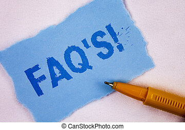 Text sign showing Faq'S Motivational Call. Conceptual photo Multiple questions answered for online product written on Tear Blue Sticky note paper on plain background Pen next to it.