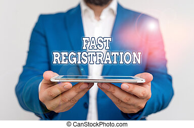 Text sign showing Fast Registration. Conceptual photo Quick method of entering certain information in a register Businessman holds laptop in his hand. Man holding mobile phone with touch screen.
