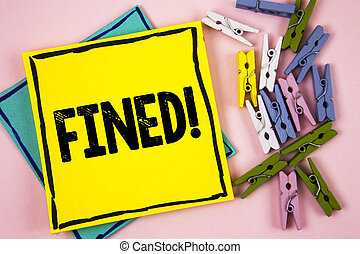 Text sign showing Fined Motivational Call. Conceptual photo No penalty charge for late credit card bill payment written on Sticky Note Paper on plain background Paper Balls and Wooden Clips.