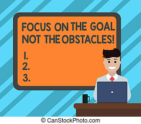 Text sign showing Focus On The Goal Not The Obstacles. Conceptual photo Be determined to accomplish objectives Blank Bordered Board behind Man Sitting Smiling with Laptop Mug on Desk.