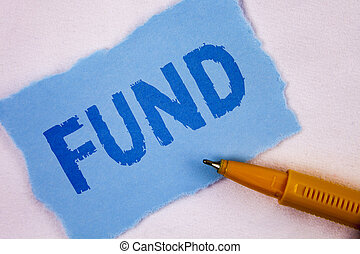 Text sign showing Fund. Conceptual photo Large amount of money is released from bank for particular purpose written on Tear Blue Sticky note paper on plain background Pen next to it.