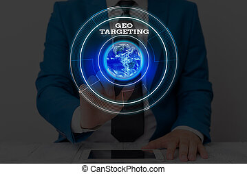 Text sign showing Geo Targeting. Conceptual photo method of determining the geolocation of a website visitor Elements of this image furnished by NASA.