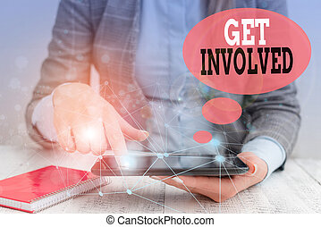 Text sign showing Get Involved. Conceptual photo Take part in an activity or event To establish an association Female human wear formal work suit presenting presentation use smart device.