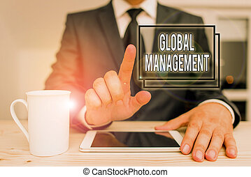 Text sign showing Global Management. Conceptual photo way an organization analysis its business internationally Male human wear formal clothes present presentation use hi tech smartphone.