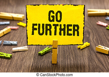 Text sign showing Go Further. Conceptual photo To move to a...