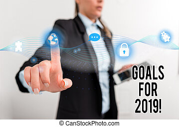 Text sign showing Goals For 2019. Conceptual photo object of demonstratings ambition or effort aim or desired result Female human wear formal work suit presenting presentation use smart device.