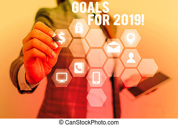 Text sign showing Goals For 2019. Conceptual photo object of demonstratings ambition or effort aim or desired result.