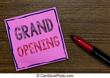 Text sign showing Grand Opening. Conceptual photo Ribbon Cutting New Business First Official Day Launching Purple Paper Important reminder Communicate ideas Marker Wooden background.