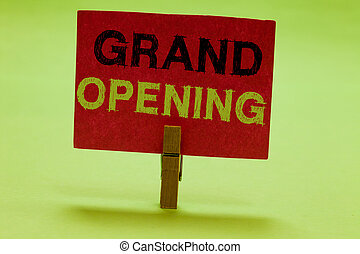 Text sign showing Grand Opening. Conceptual photo Ribbon Cutting New Business First Official Day Launching Clothespin holding red paper important communicating messages ideas.