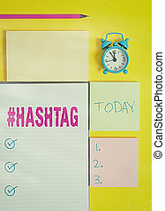Text sign showing Hashtaghashtag. Conceptual photo word preceded by a hash sign hashtag on social media websites Colored empty papers with copy space on the yellow background table.
