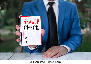 Text sign showing Health Check. Conceptual photo Medical Examination Wellness and general state Inspection Man holds empty paper with copy space in front of him.