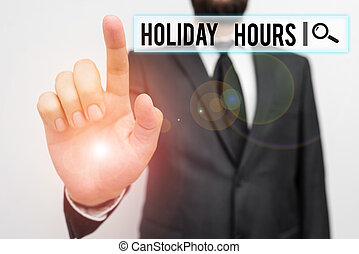 Text sign showing Holiday Hours. Conceptual photo employee receives twice their normal pay for all hours Male human with beard wear formal working suit clothes raising one hand up.