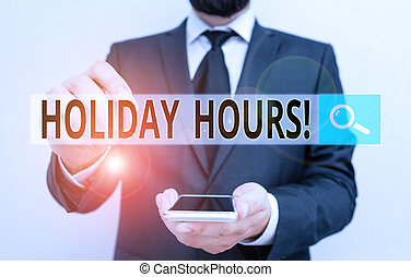 Text sign showing Holiday Hours. Conceptual photo Overtime work on for employees under flexible work schedules Male human wear formal work suit hold smart hi tech smartphone use one hand.