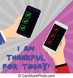 Text sign showing I Am Thankful For Today. Conceptual photo Grateful about living one more day Philosophy Two Hu analysis Hands Each Holding Blank Smartphone Mobile on Sunburst photo.