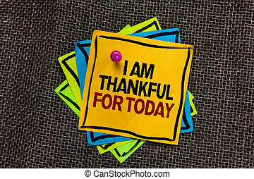 Text sign showing I Am Thankful For Today. Conceptual photo Grateful about living one more day Philosophy Black bordered different color sticky note stick together with pin on jute sack.