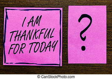 Text sign showing I Am Thankful For Today. Conceptual photo Grateful about living one more day Philosophy Violet color black lined sticky note with letters black question mark.