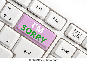 Text sign showing I M Sorry. Conceptual photo Toask for forgiveness to someone you unintensionaly hurt White pc keyboard with empty note paper above white background key copy space.