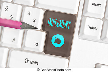 Text sign showing Implement. Conceptual photo to provide instruments or means of expression for something Different colored keyboard key with accessories arranged on empty copy space.