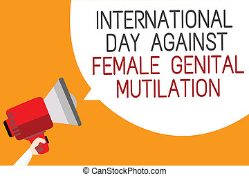 Text sign showing International Day Against Female Genital...