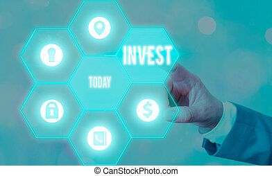Text sign showing Invest. Conceptual photo commercial venture with the expectation of achieving a profit.