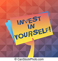 Text sign showing Invest In Yourself. Conceptual photo learn new things or materials thus making your lot better Hand Holding and Raising Blank Space Colorful File Folder with Sheet Inside.