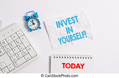 Text sign showing Invest In Yourself. Conceptual photo learn new things or materials thus making your lot better Blank paper with copy space on the table with clock and pc keyboard.
