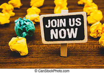 Text sign showing Join Us Now. Conceptual photo enroll community register website Recruit someone Sign-up Blackboard with letters wooden floor blurry yellow paper lumps green lob.